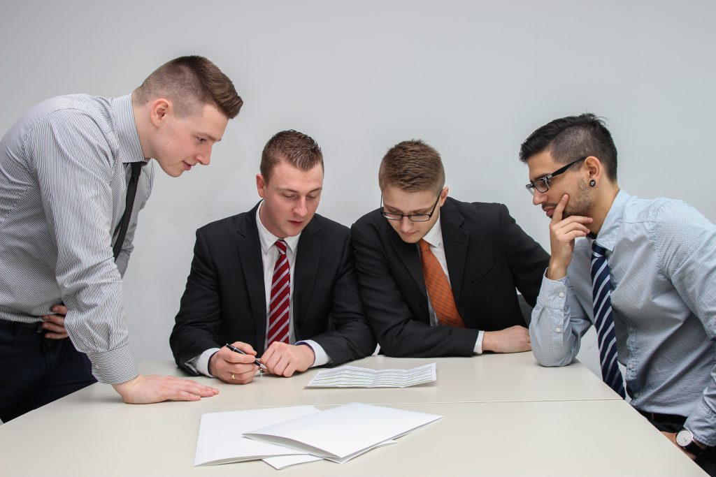 a group of employees discussing together