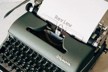 a typewriter printing a paper