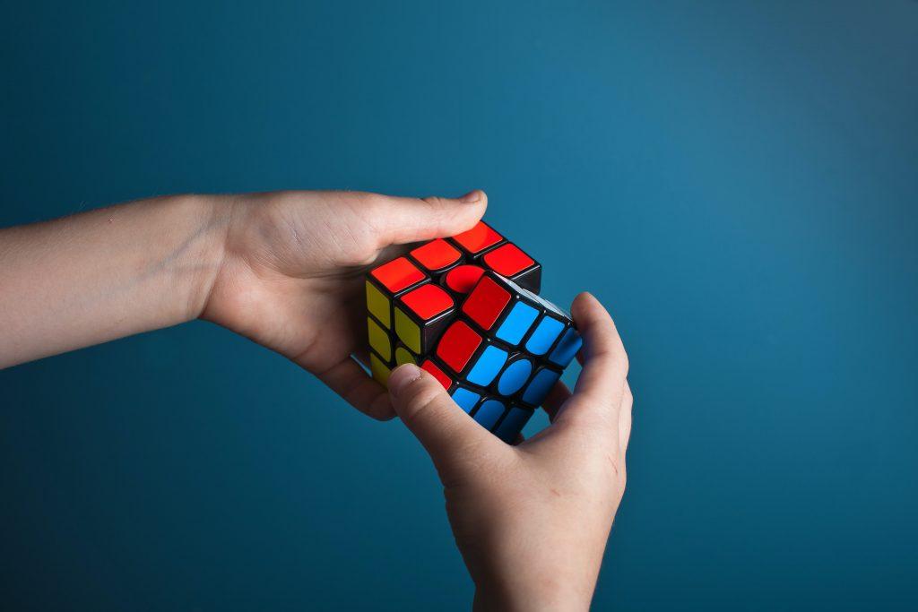 person solving rubik's cube