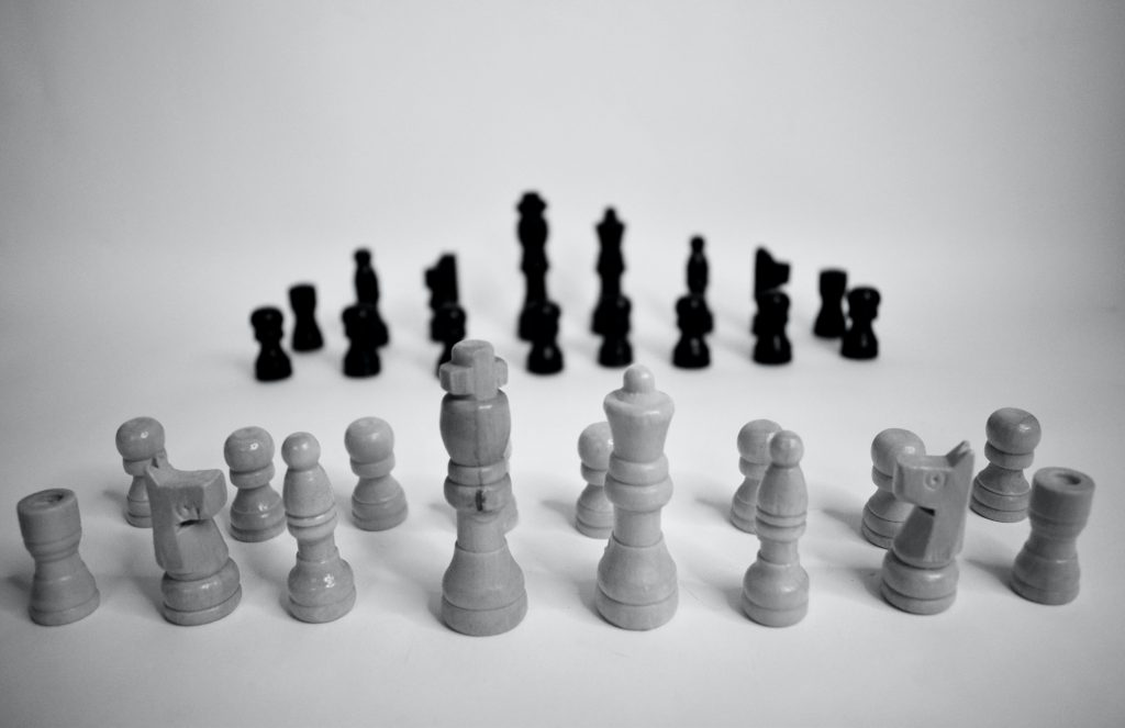 chess pieces of two different colors