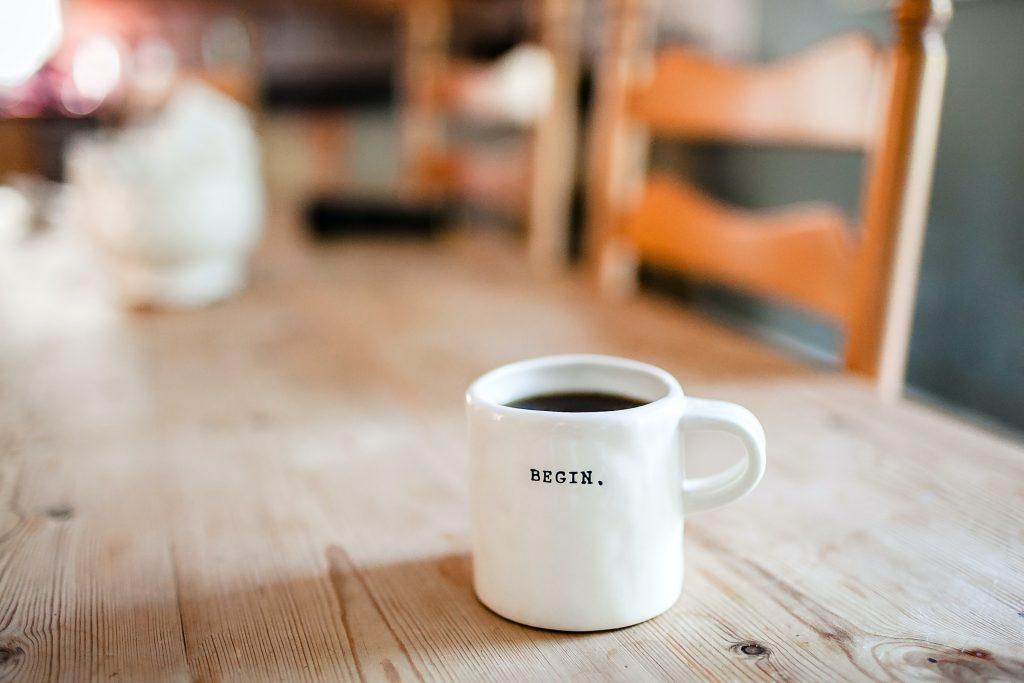 A coffee mug with a motivational word.